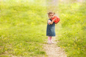 adorable baby girl playing outdoors