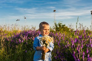 Cute boy with flowers
