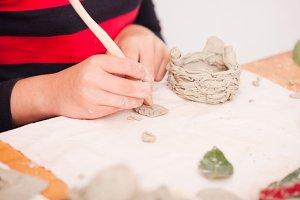 Child hands with plasticine