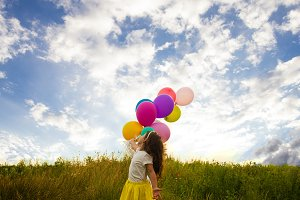 Happy child with colorful balloons