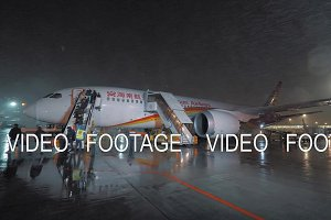 Deboarding Hainan Airlines plane in Sheremetyevo Airport at night