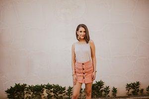 Girl posing by wall