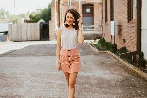 Fashionable girl walking on street