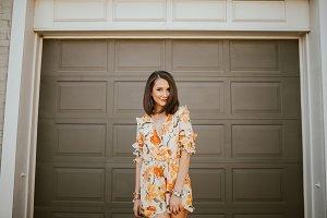 Trendy girl posing by door