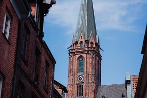 Traditional facades and roofs, Gothic Cathedral church in the historic centre of Luneburg, Germany