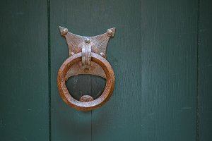 Old rusty gate latch on the door