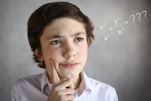teenager clever boy thinking difficult equation