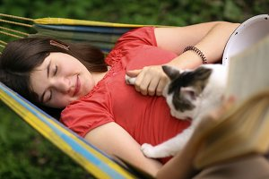 summer sunny photo of teenager girl hugging cat