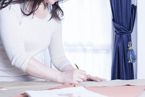 dressmaker drawing a pattern