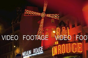 Street with Moulin Rouge in Paris, view at night