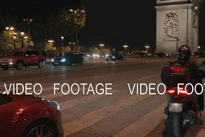 People and transport traffic in night Paris, view with Arc de Triomphe