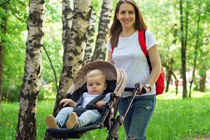 Mom takes her son in baby carriage.