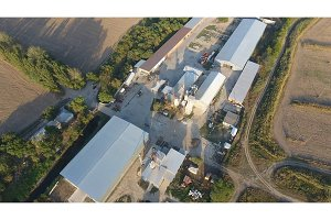 Rice plant. Hangar for storage of grain. A platform for drying and sintering grain. Harvested grain