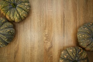 frame with pumpkins on a wooden table