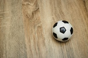 Soccer ball on the wooden floor