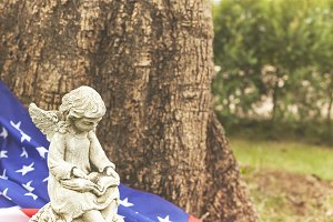 Winged girl angel  statue with the flag of america decorating