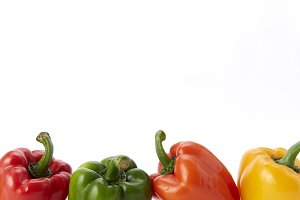Colorful bell pepper vegetable on white background