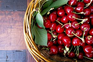 Red ripe cherries on basket