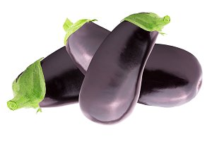 Three fresh eggplant over white