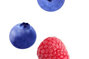 Flying raspberry and blueberry fruit
