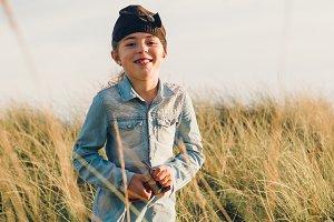 Little girl standing on beach