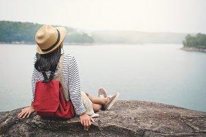 Asian girl backpacker in nature