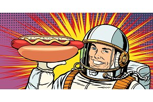 Smiling male astronaut presents hot dog sausage