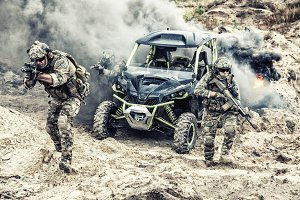 Patrol of three soldiers on buggy attacking enemy