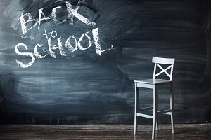 Sign back to school on a black chalk