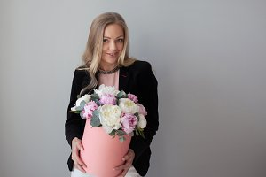 Charming blonde woman with flowers