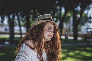 Redhead girl with long curly hair