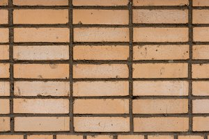 Yellow masonry brick texture