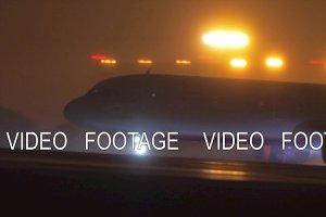 Aeroflot plane gaining speed on runway before taking off at night