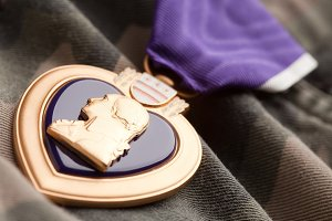 Purple Heart War Medal on Camouflage Material