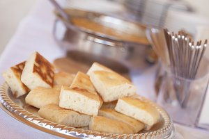 Tray of Fresh Made Italian Bread on Serving Table.