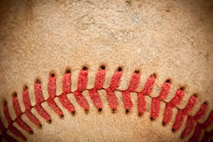 Macro Abstract Detail of Worn Leather Baseball with Vignette.