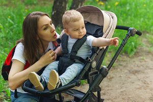 Family. Mom and son in baby carriage