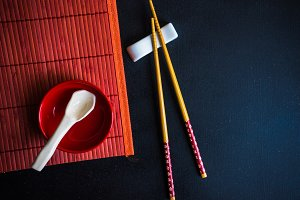 Table setting for asian food in red