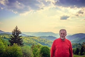Senior man and beautiful landscape