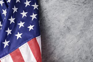 American flag on cement background