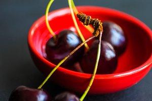 Sweet cherries in red bowl