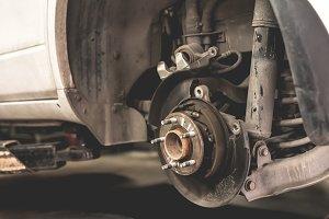 Car wheel repair in garage