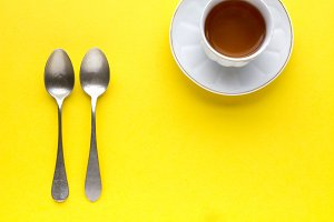 Red tea and teaspoons