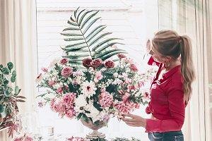 Women and bouquet in urn vase
