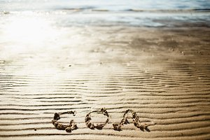 The word Goa is written on the sand by the sea. Trace on the beach. Outflow of the sea