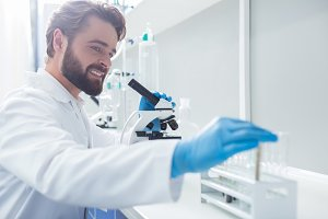 Positive smart biologist taking a test tube