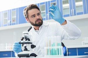 Professional bearded biologist holding medicine