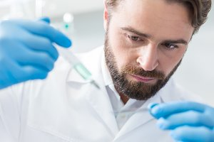 Serious bearded biologist conducting an analysis