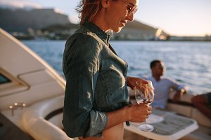 Woman partying on private boat