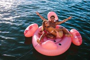 Couple enjoying inflatable toy ride